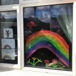 Drawing of rainbow in window