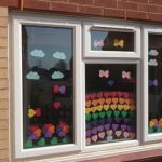 Rainbow coloured hearts in window