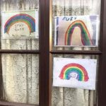 Drawing of rainbows in window