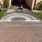 Chalked rainbow on driveway