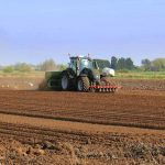Tractor sowing potatoes